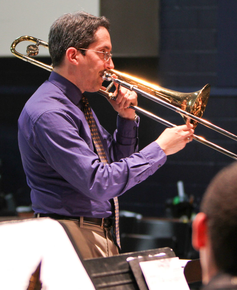 Antonio García demonstrates stylistic phrasing for a participating band.