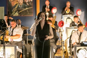 Lauren Kinhan performing with a big band at the Jazz Loft
