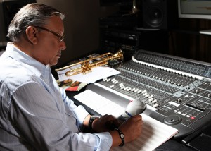 Arturo Sandoval behind the console while working on a new recording.